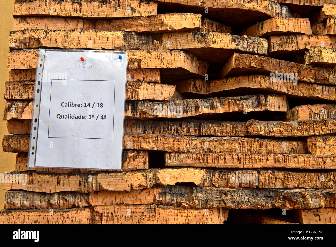 Graded bark of the cork oak (Quercus suber), cork factory Novacortiça, São Brás de Alportel, Algarve, - Stock Image