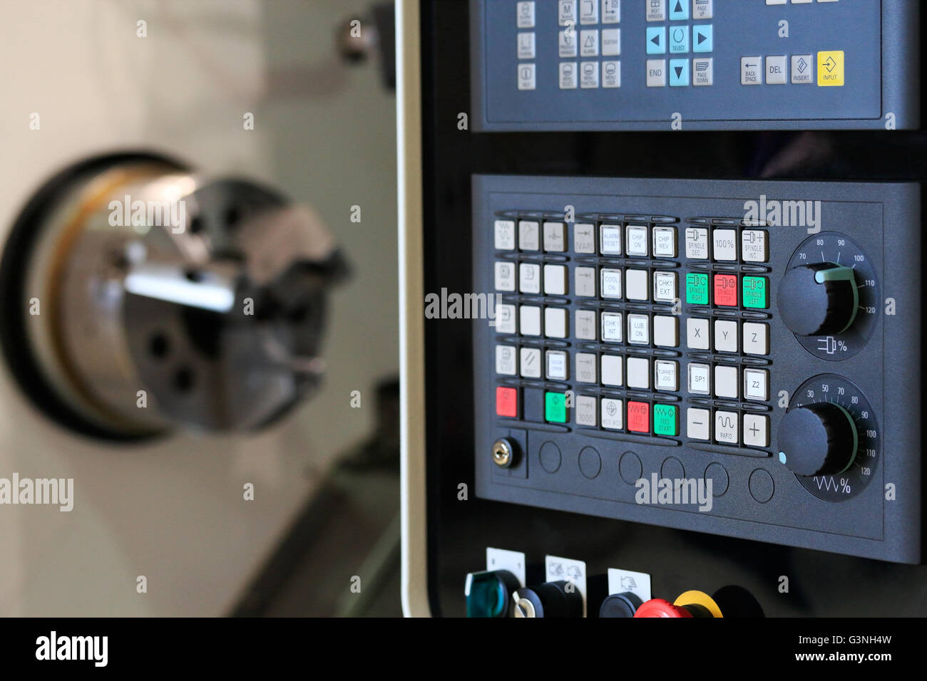 Close up of horizontal cnc turn mill machine with open door. Selective focus on control panel. - Stock Image