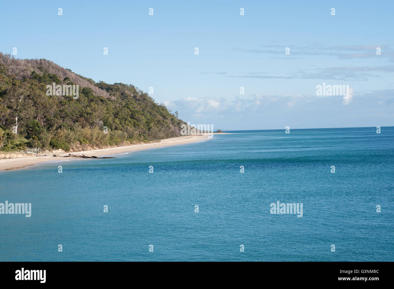 Coast of Tangalooma island resort in Queensland Australia with very blue ocean - Stock Image