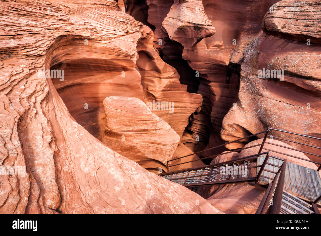 Metal staircase leading down into unusual sandstone rock formations inside the Lower Antelope Canyon, Page, Arizona, - Stock Image
