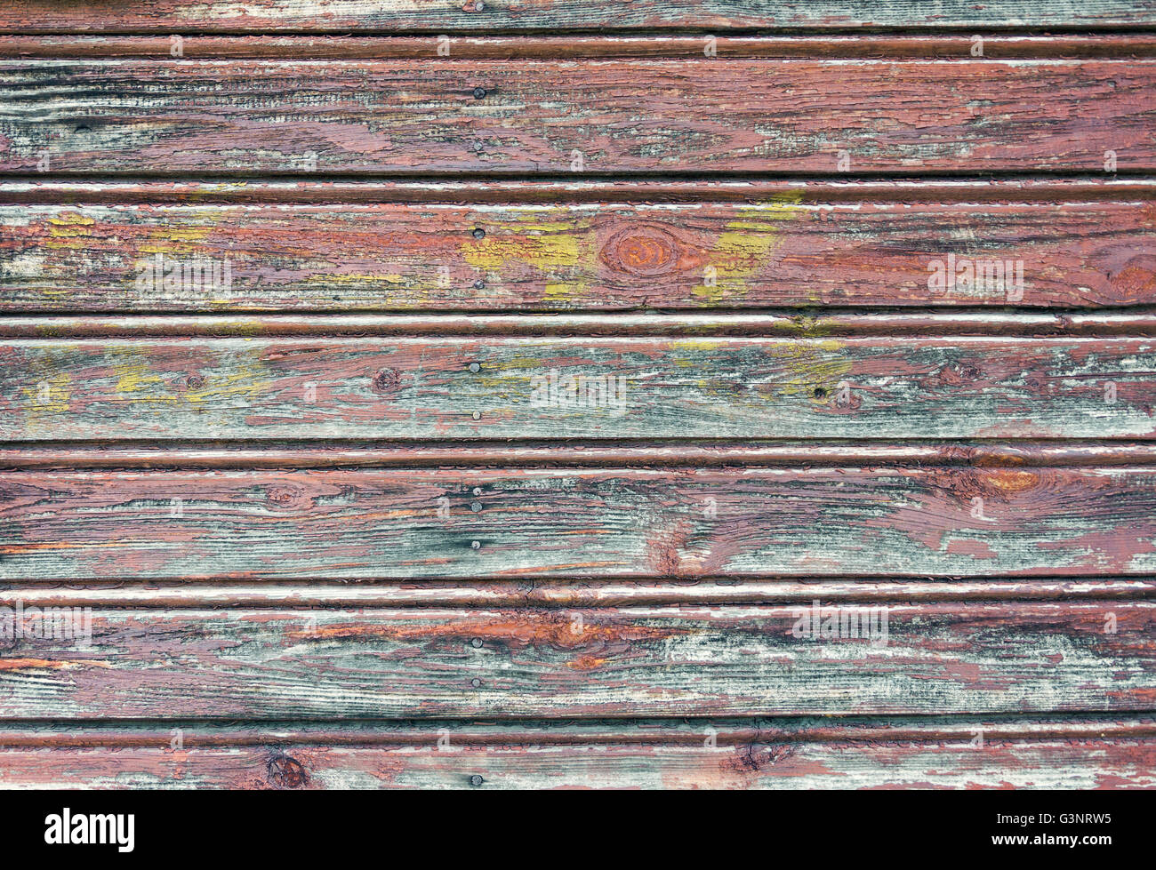 Old wooden planks texture with weathered paint - Stock Image