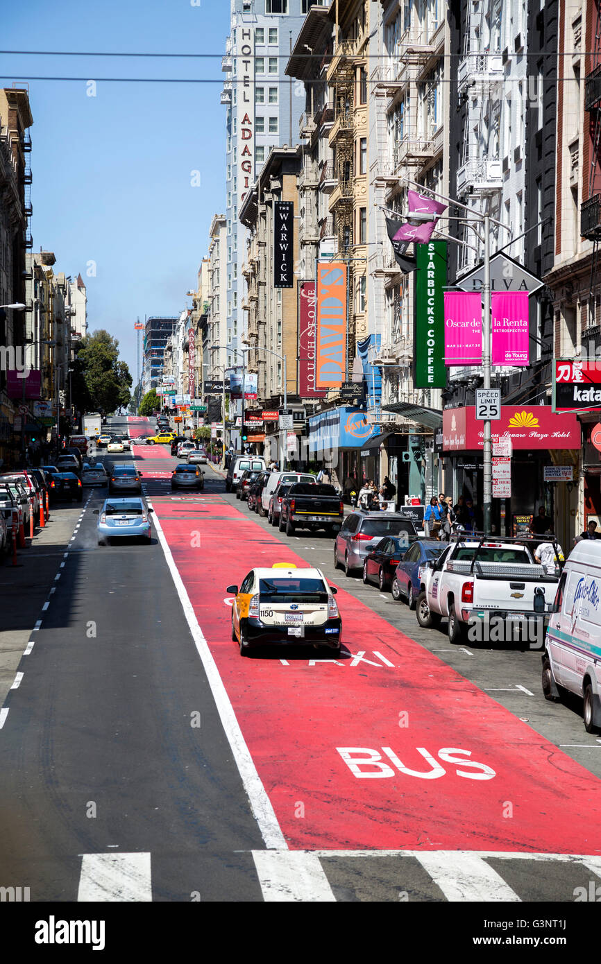 Street scene in San Fransisco showing taxi in the taxi bus lane. - Stock Image