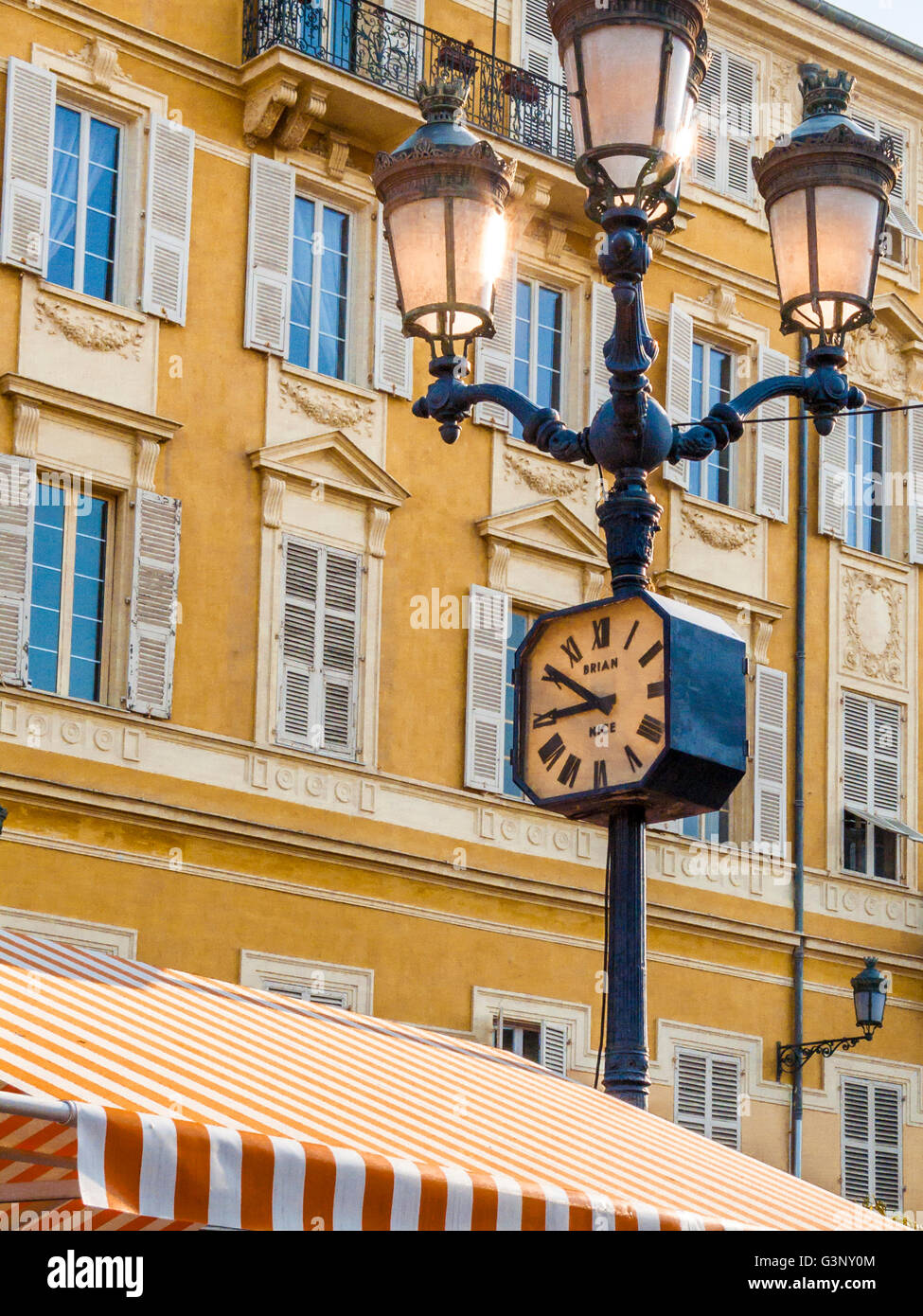 Clock on lamp post Nice market, Cote d'Azur, Nice, France, Europe - Stock Image