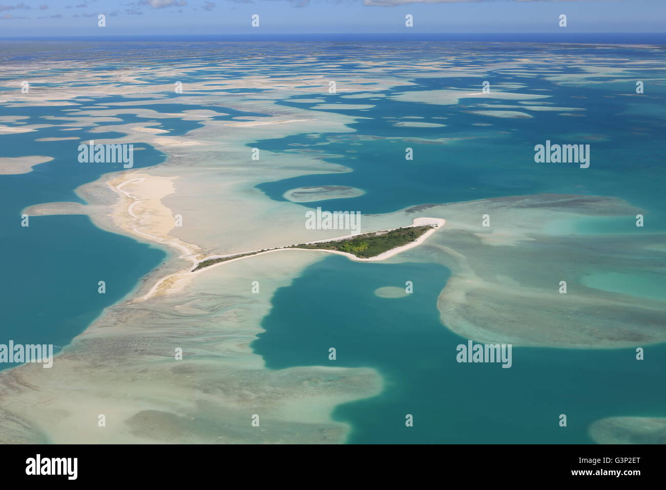 Aerial view of Motu Tabu Islet in blue lagoon of Christmas Island (Kiritimati), Kiribati - Stock Image