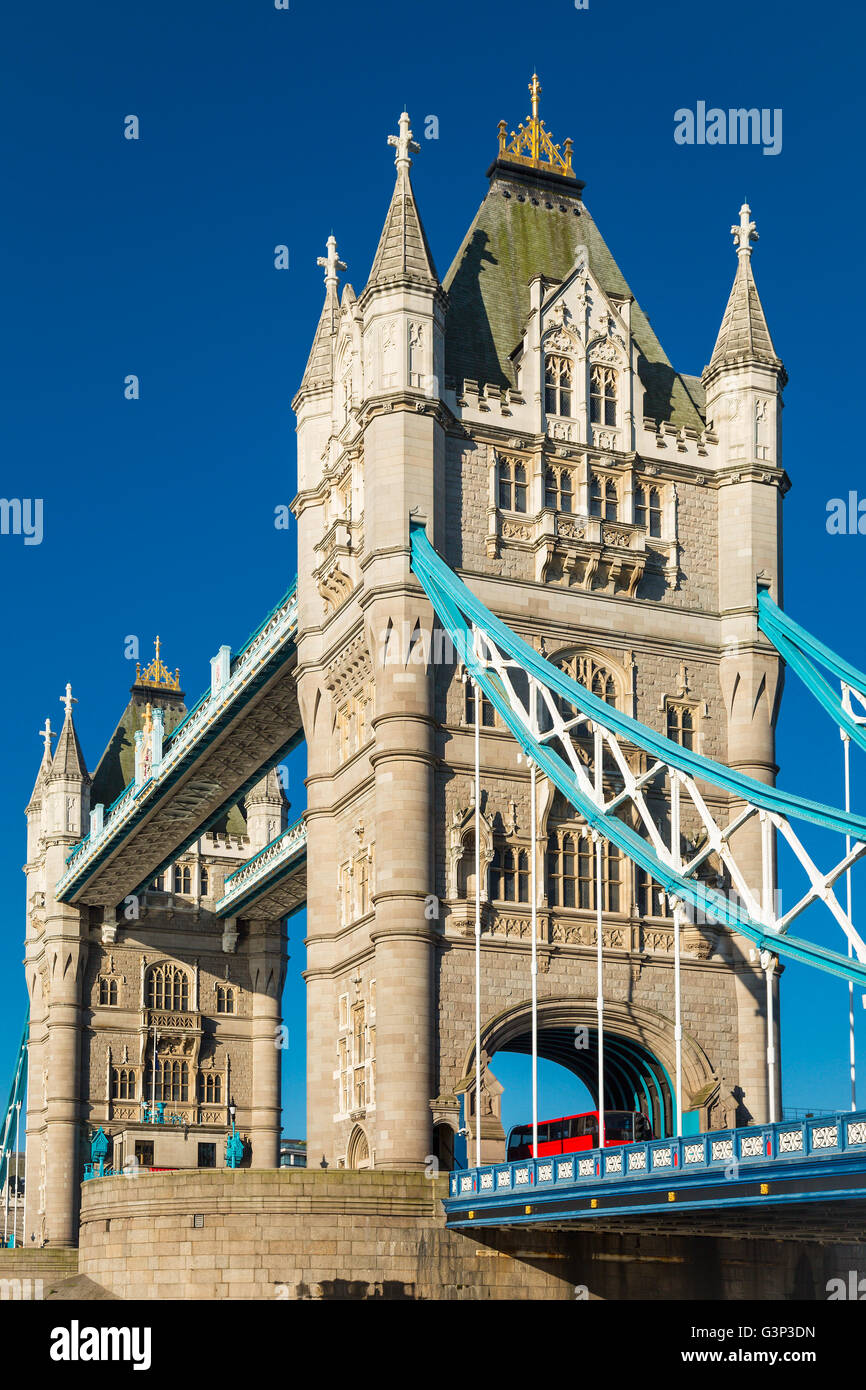 Tower bridge in London with a red bus - Stock Image