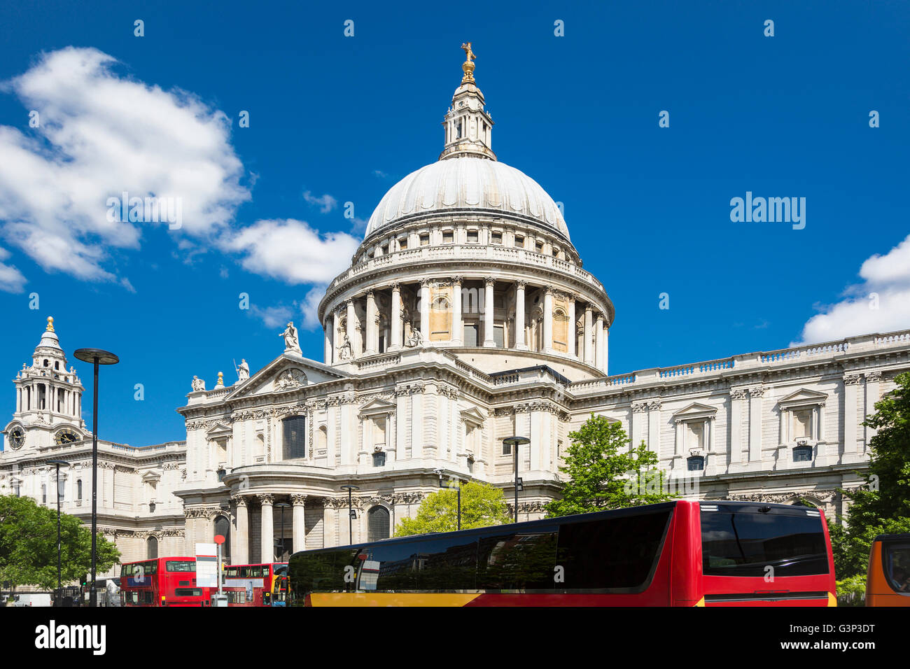 St Paul's Cathedral in London with red buses, with blue sky and white cloud Stock Photo
