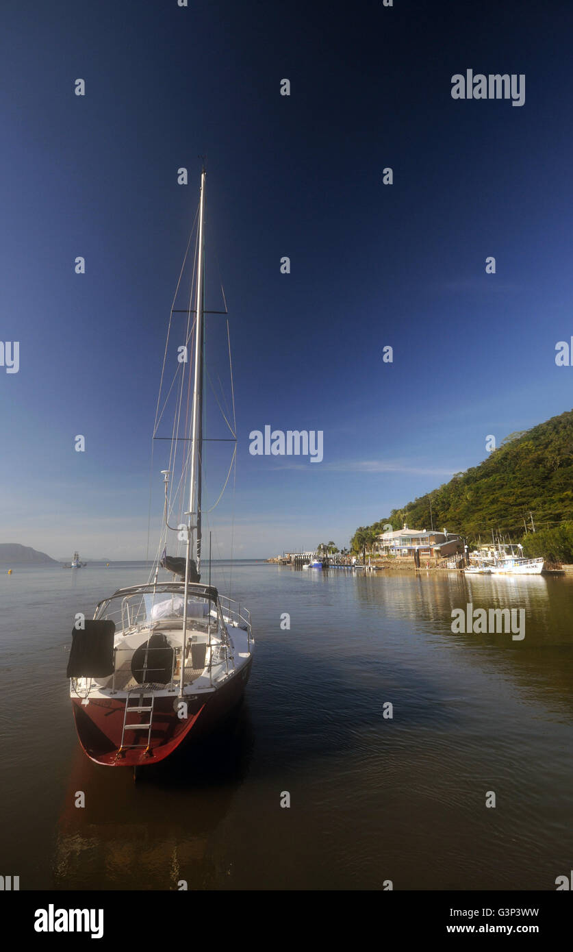 Yacht and other boats moored in the Endeavour River, Cooktown, Queensland, Australia. No PR - Stock Image