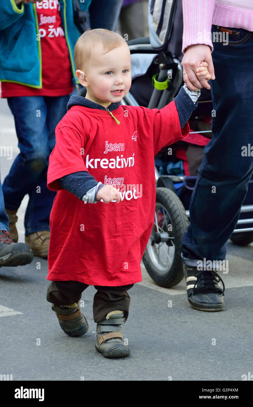 Small child taken on a march - April 2nd, Prague, Czech Republic. Annual National March for Life - pro-life demonstration... - Stock Image