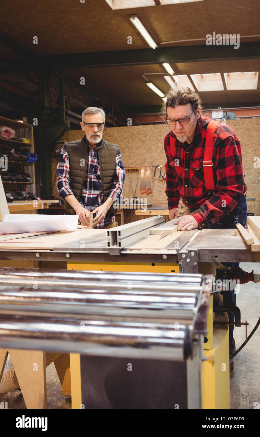 Duo of carpenter working - Stock Image