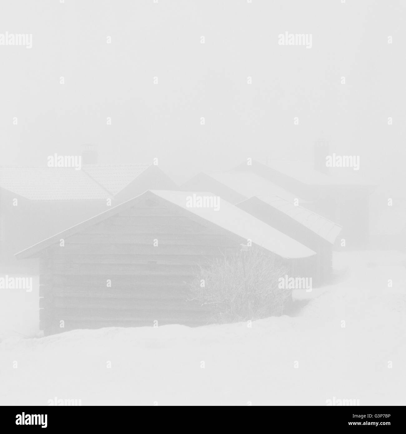 Sweden, Dalarna, Orsa, Wooden house in winter - Stock Image
