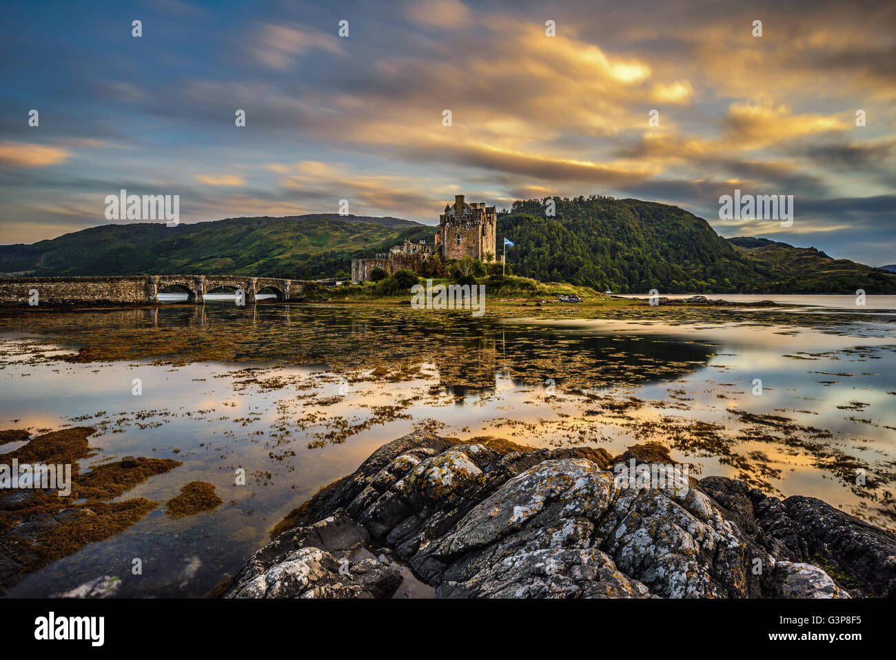 Sunset over Eilean Donan Castle, Scotland, United Kingdom. Long exposure. Stock Photo