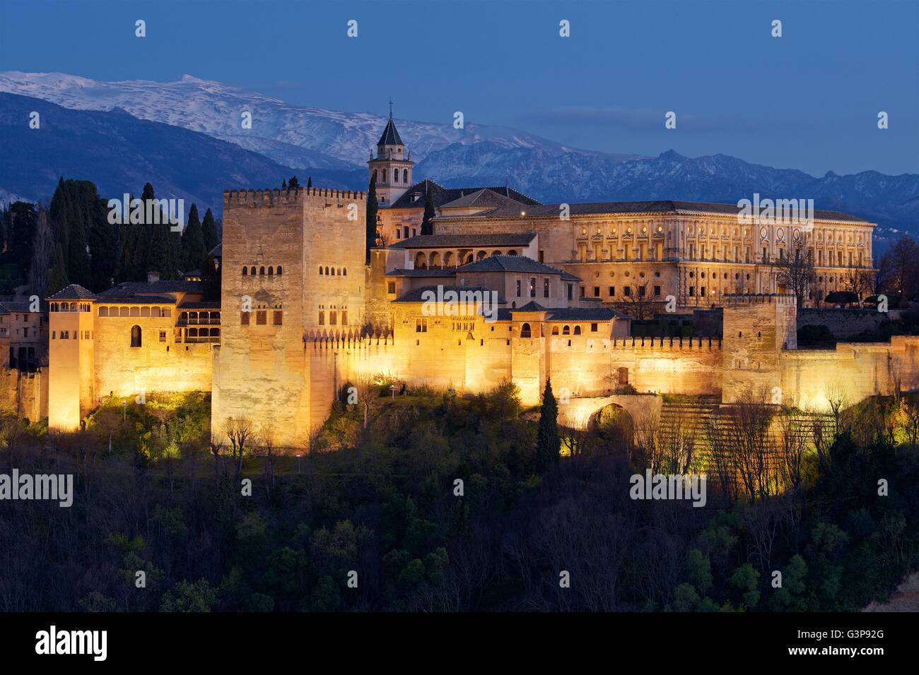 A night time image taken from Mirador San Nicholas of the Alhambra palace lit up at night - Stock Image