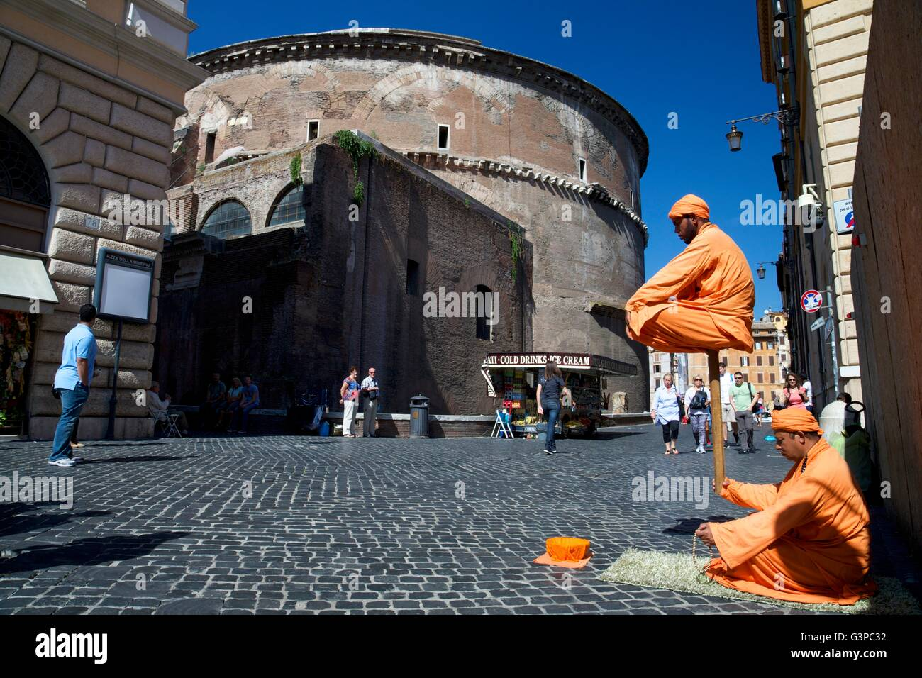 Levitating man street entertainers near Pantheon, Rome, Italy, Europe - Stock Image
