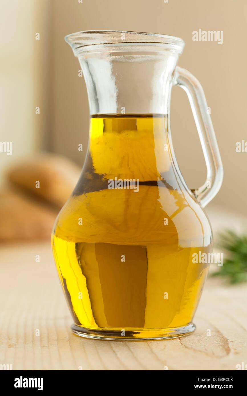 Jar of mediterranean olive oil - Stock Image