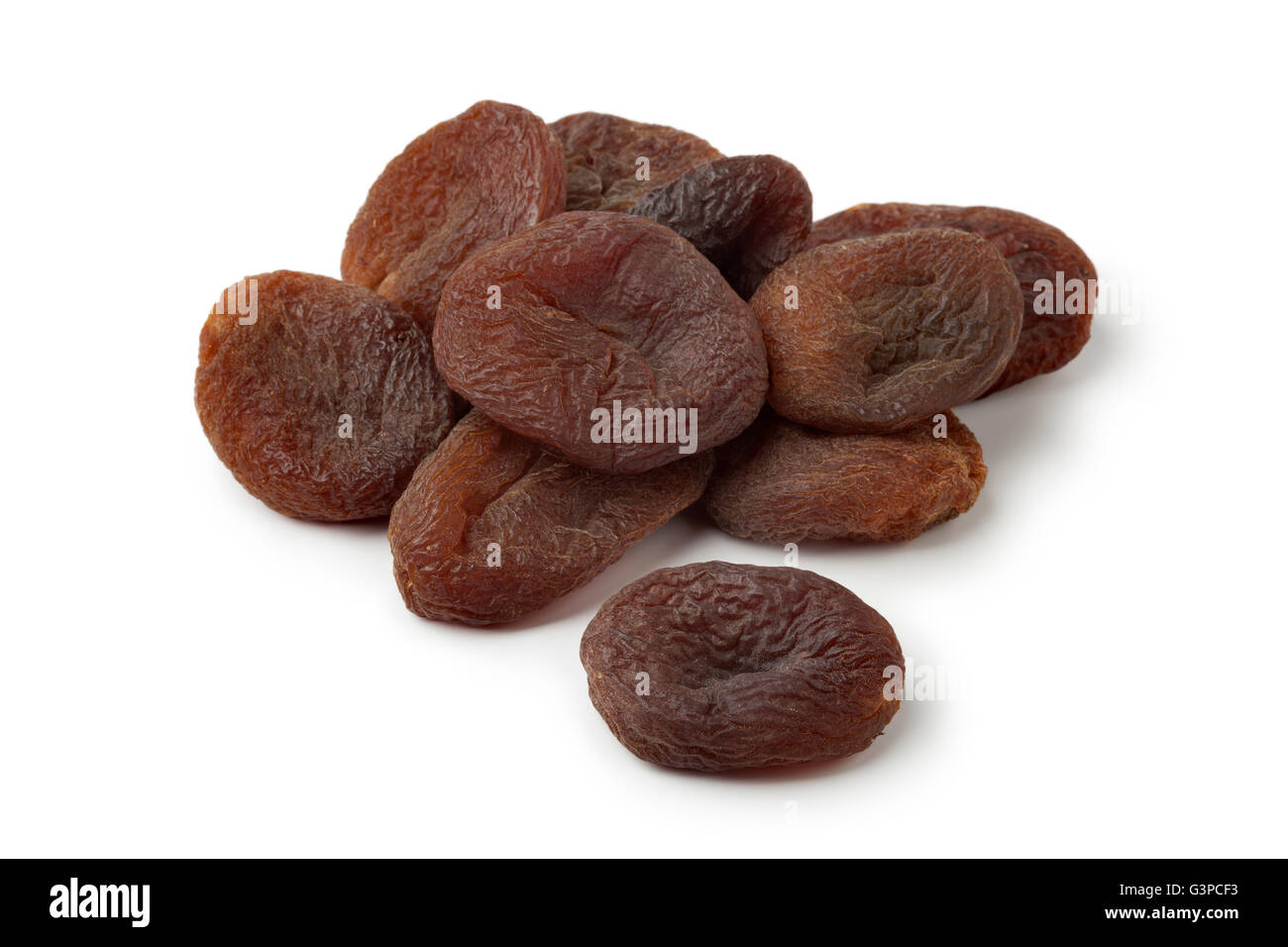 Heap of healthy nutritious sun dried apricot fruit on white background - Stock Image