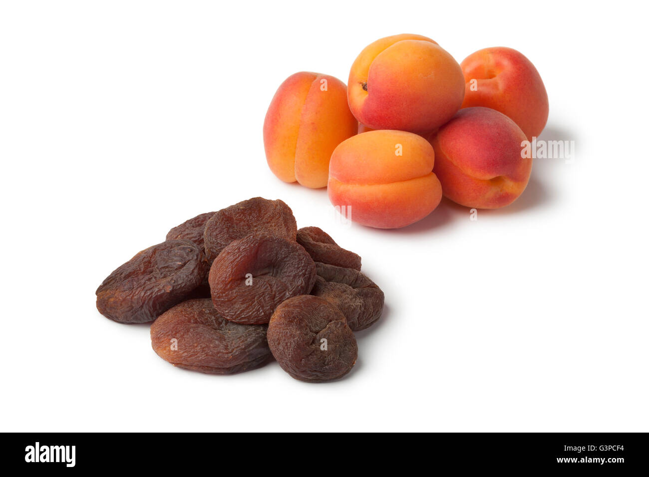 Healthy fresh and sun dried apricot fruit on white background - Stock Image