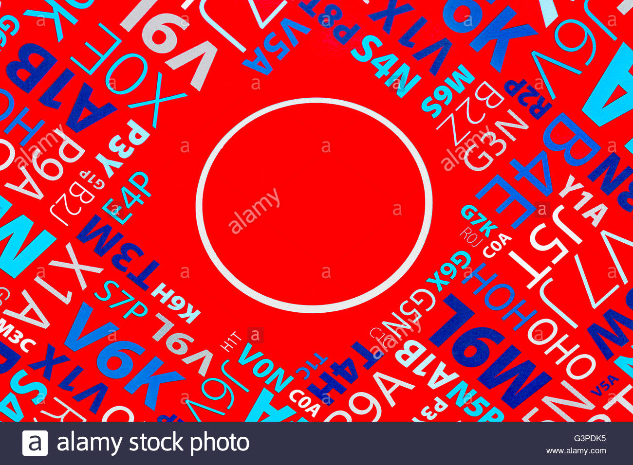 Composition of letters and digits on bright red background macro - Stock Image