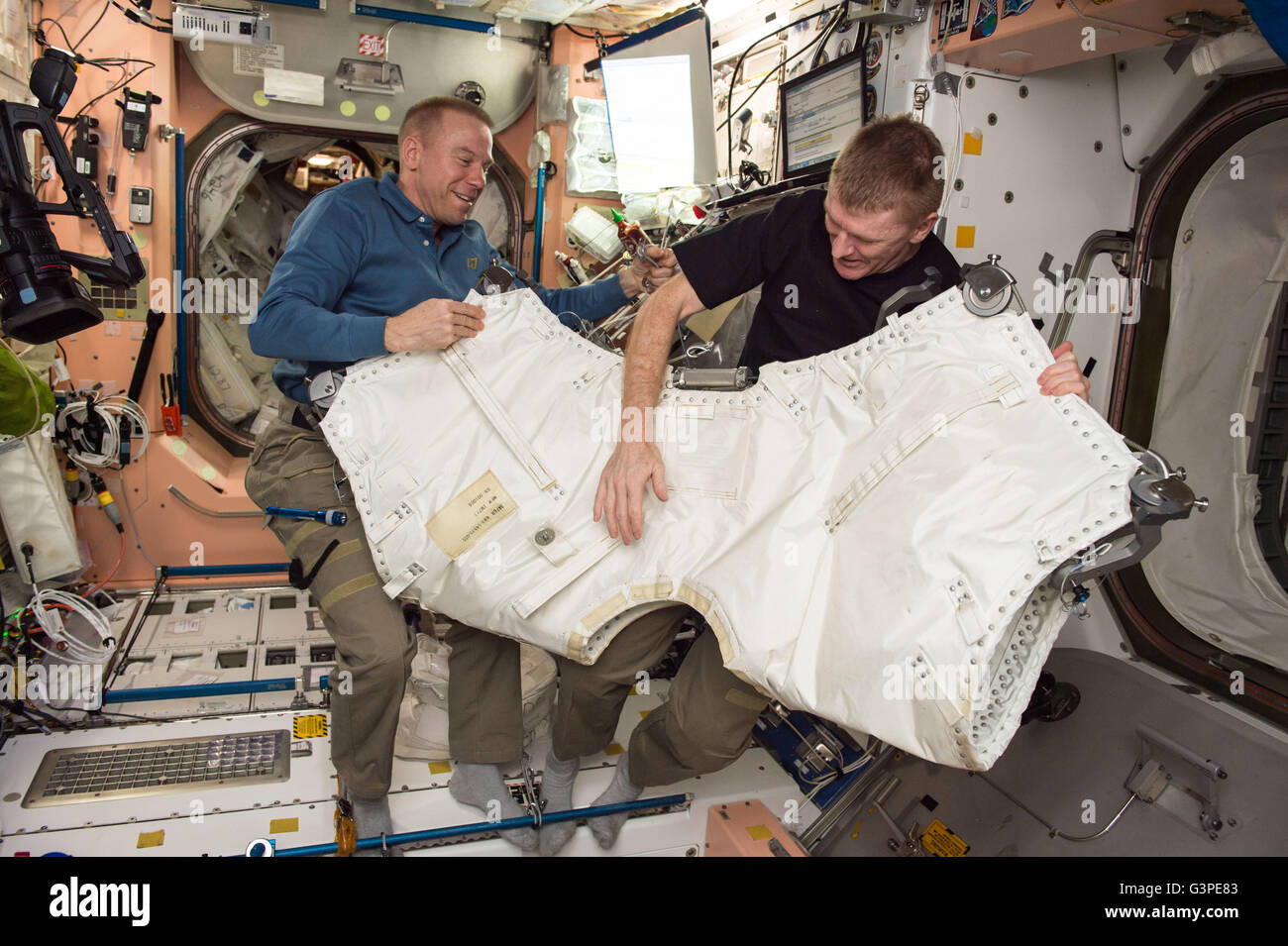 International Space Station Expedition 47 NASA astronaut Tim Kopra, left, and  ESA astronaut Timothy Peake gather - Stock Image