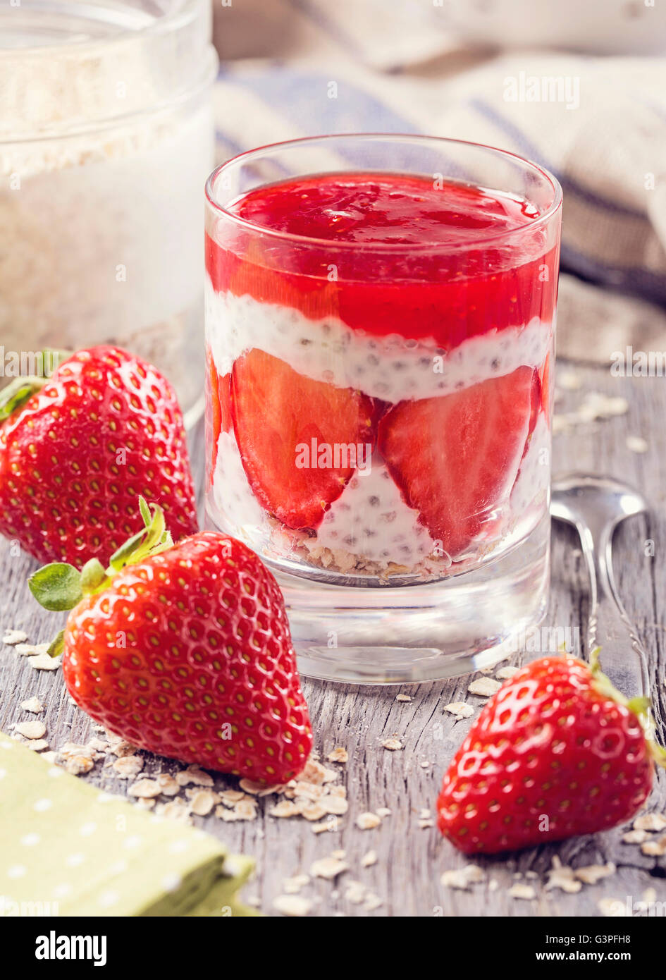 Strawberry chia pudding with oat flakes - Stock Image