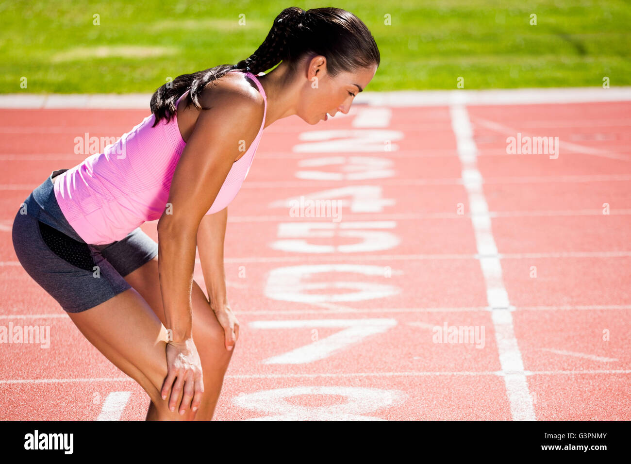 Composite image of profile view of breathless sportswoman - Stock Image