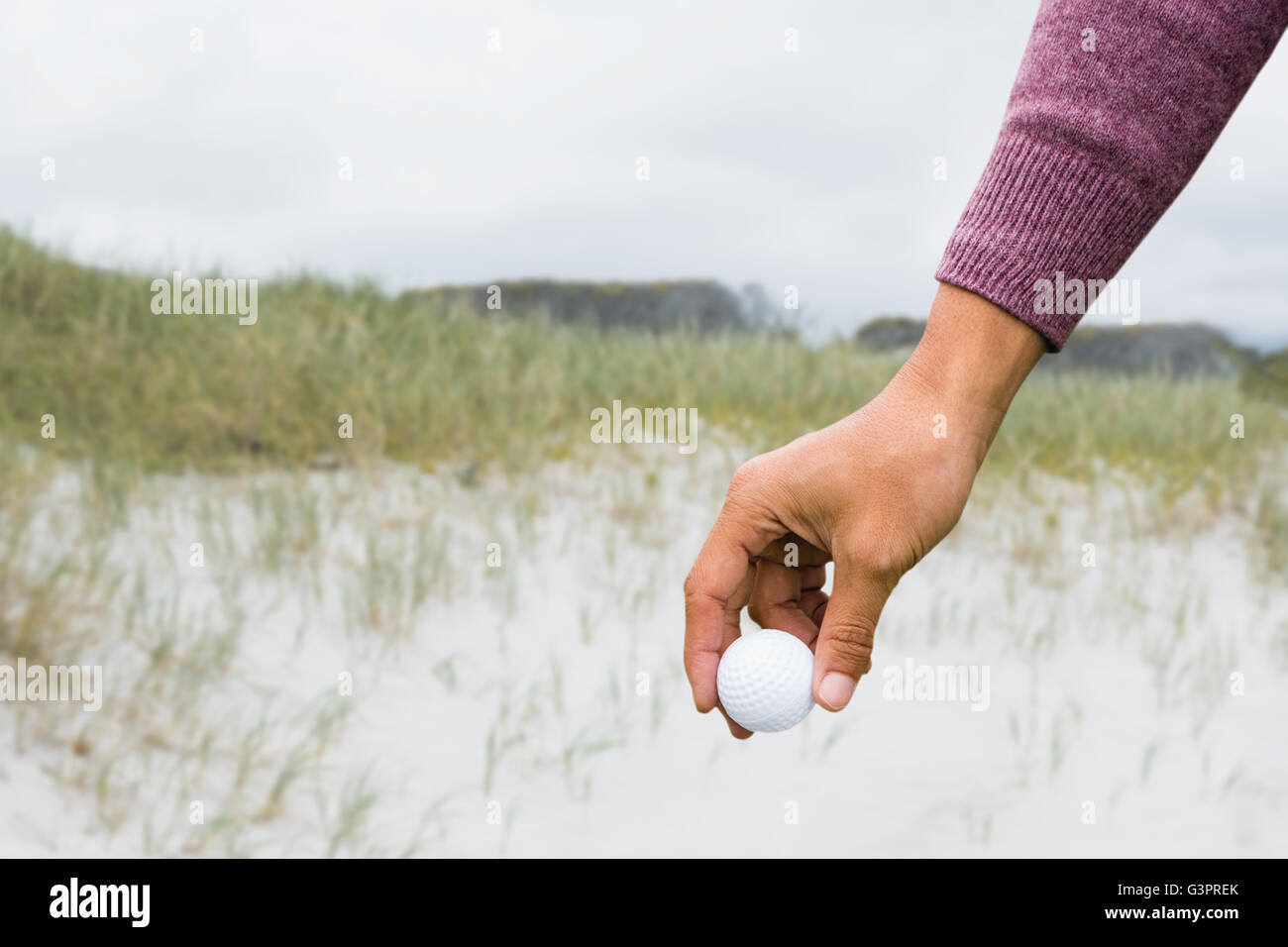 View of hand with golfball - Stock Image