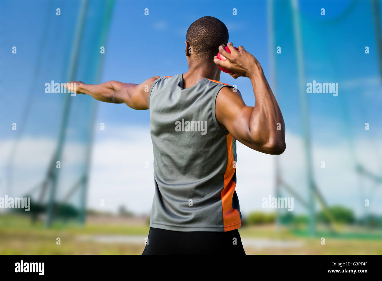 Composite image of rear view of athletic man preparing the shot put Stock Photo