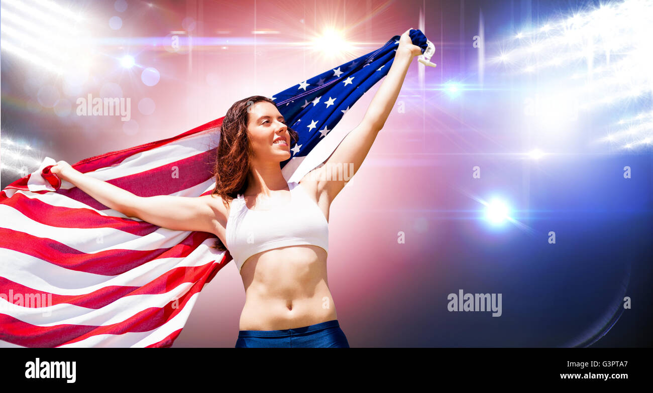 a9f6a5f5c9 Happy sportswoman posing with an american flag against composite image of  orange spotlight stock image jpg