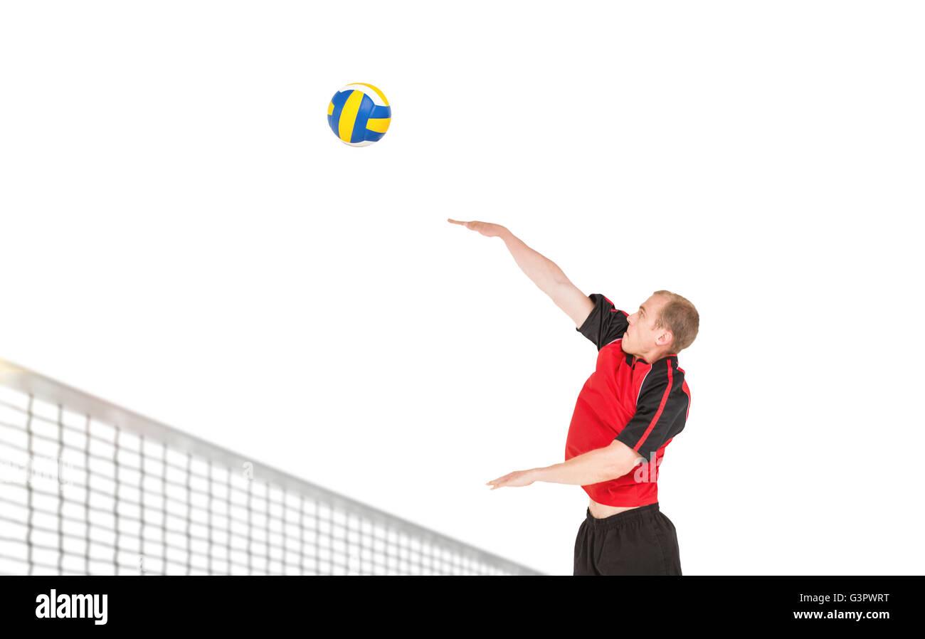 Sportsman hitting volleyball - Stock Image