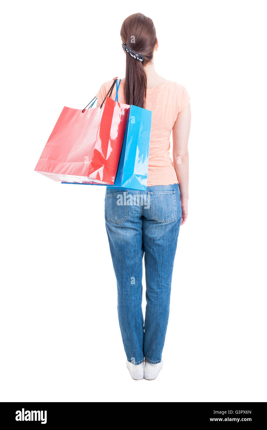 Backview and full body of woman standing and carrying shopping bags on shoulder looking up isolated on white background - Stock Image