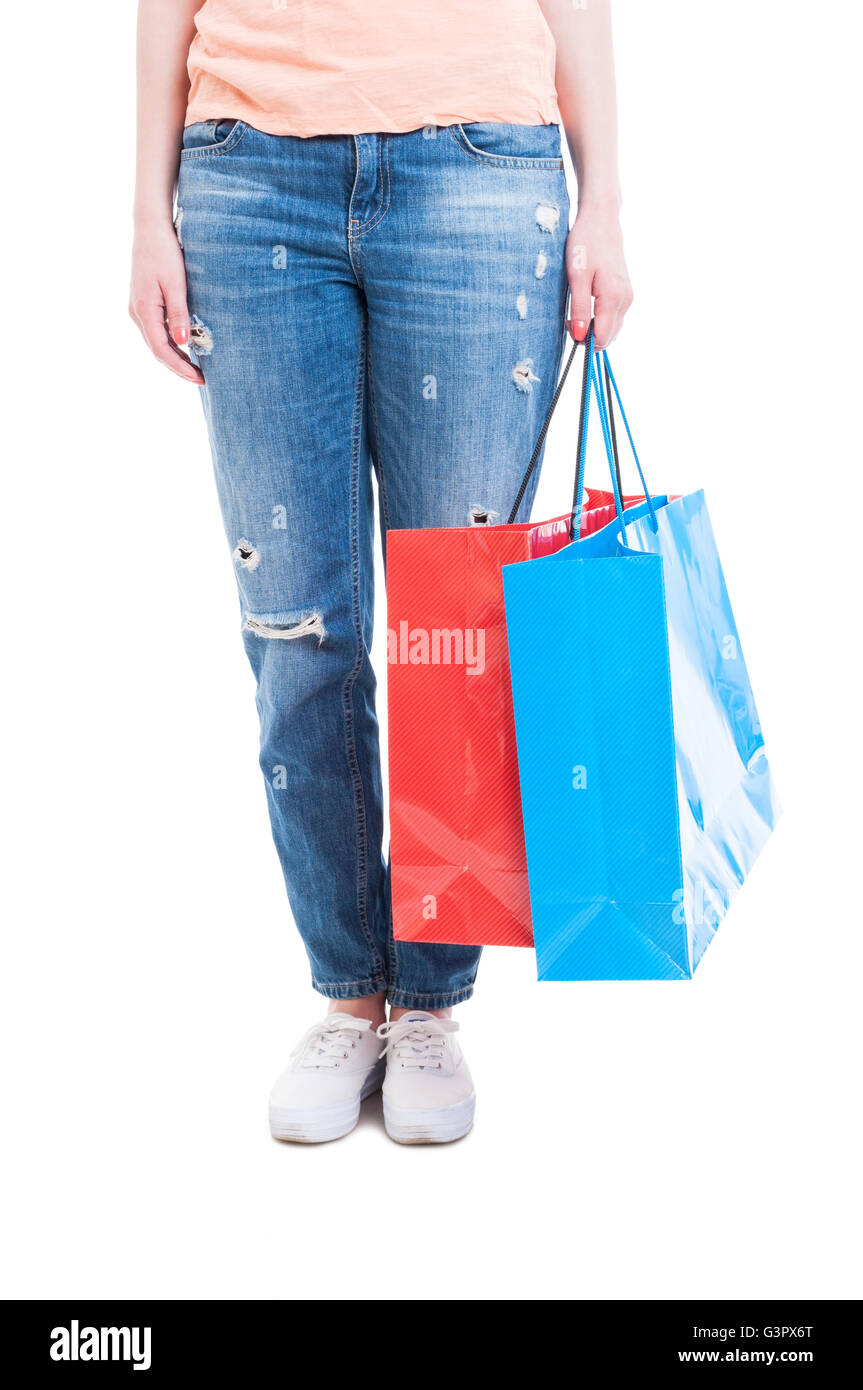 Consumerism concept with woman holding big shopping bags isolated on white background with copy text space - Stock Image