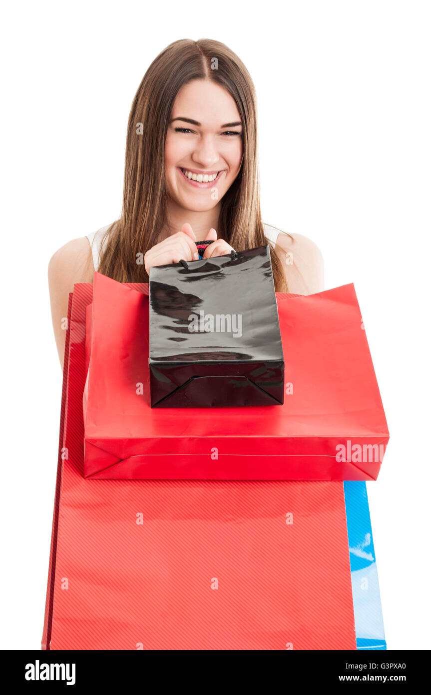 Shopping or consumerism concept with cheerful attractive female with colored paper bags isolated on white background - Stock Image