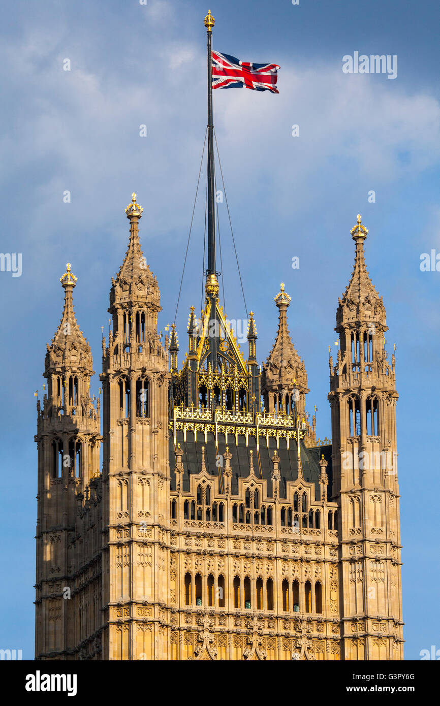 The Union Flag flying from the top of the Victoria Tower at the Houses of Parliament in London. - Stock Image