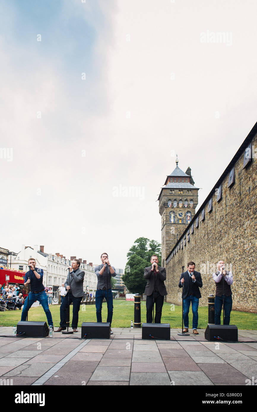 Only Men Aloud perform outside Cardiff Castle as part of the Choir Clock during Wales Millennium Centre's inaugural - Stock Image