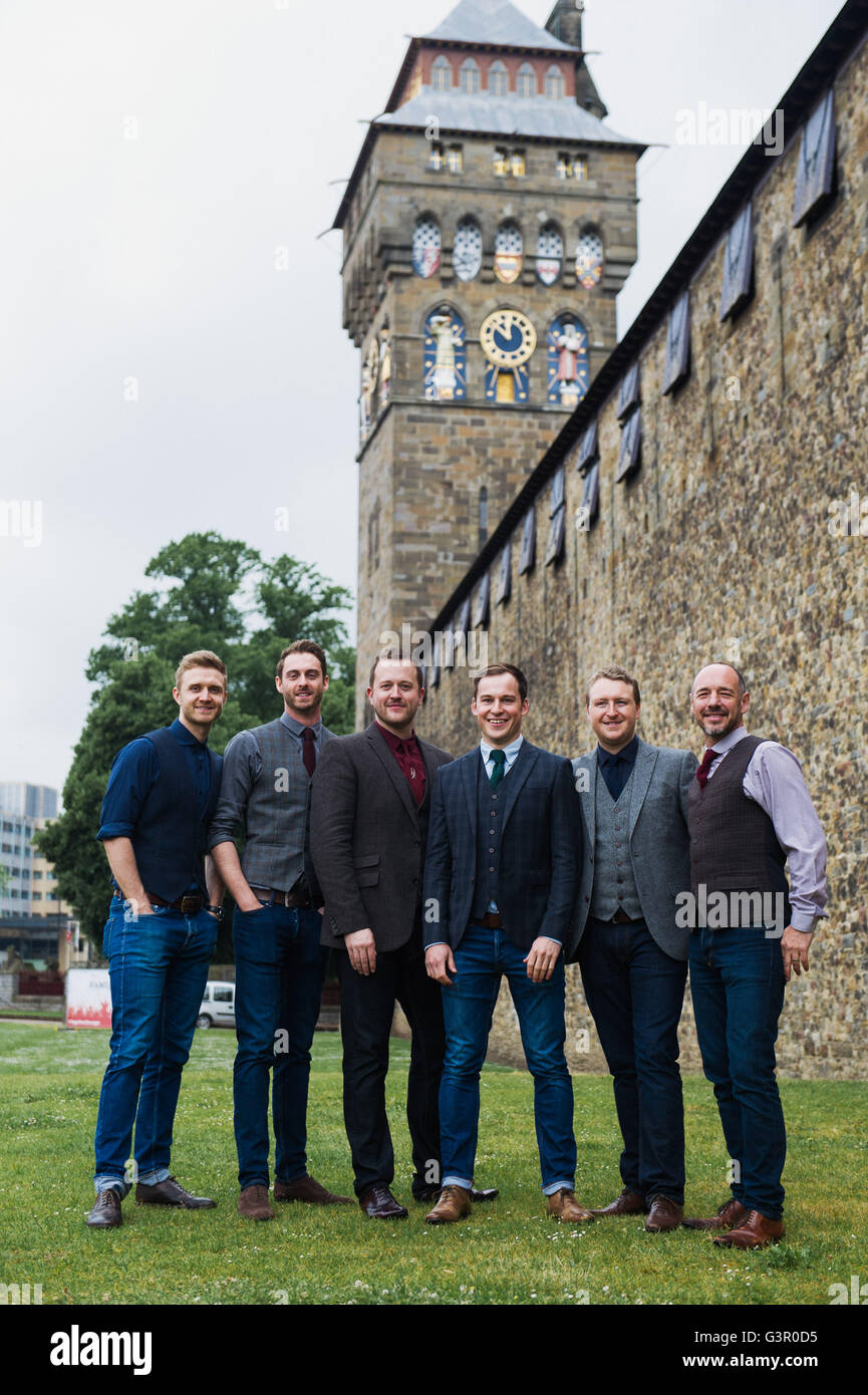 Welsh band Only Men Aloud outside Cardiff Castle. - Stock Image