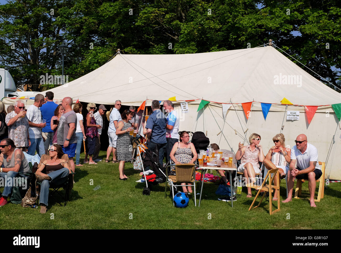 People At A Traditional English Summer Party On The Green Or Fete In East Preston West Sussex Village UK