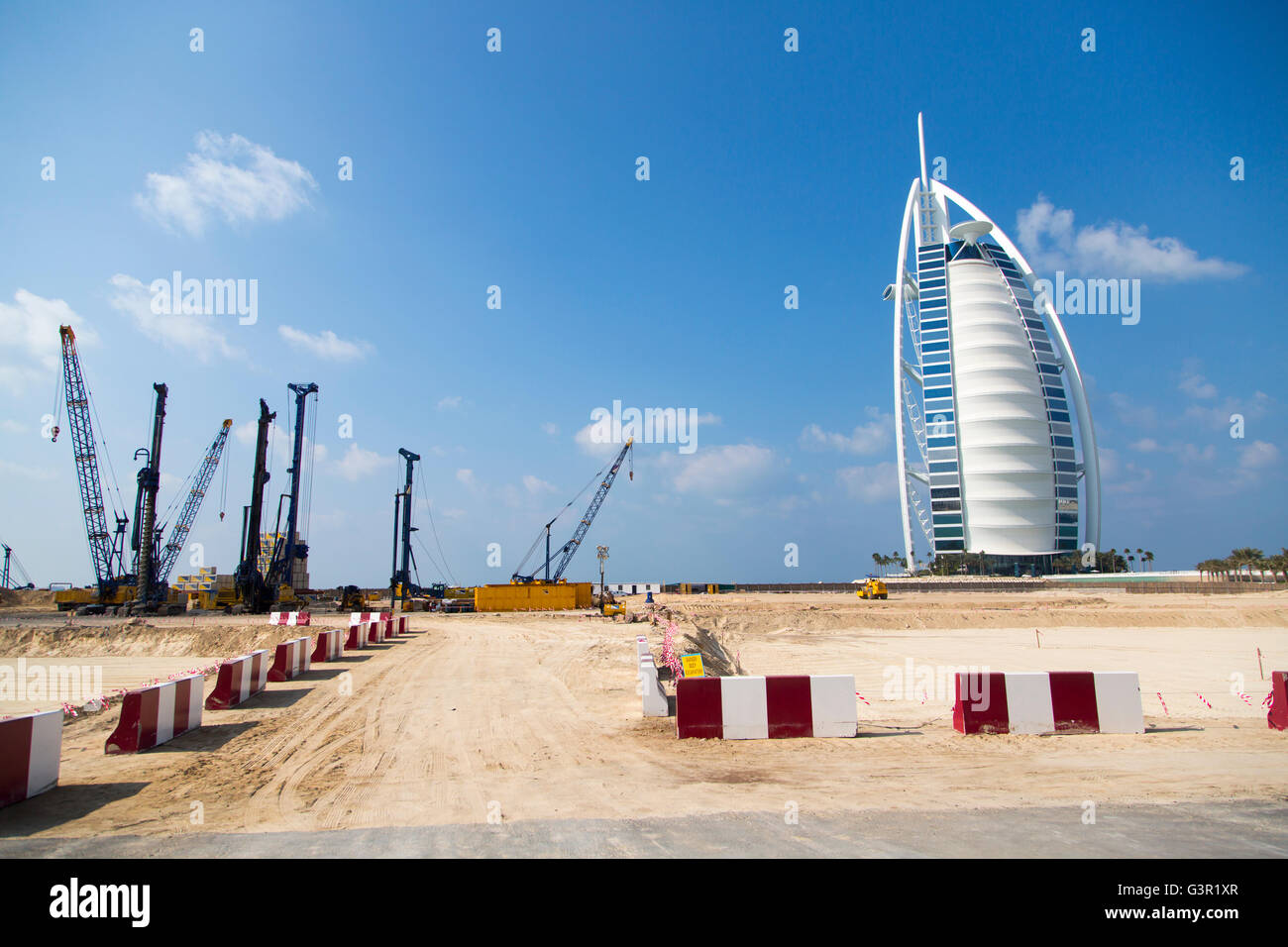 DUBAI, UAE - JANUARY 16, 2014: Burj Al Arab hotel in Dubai. The complex stands on an artificial island and is connected - Stock Image