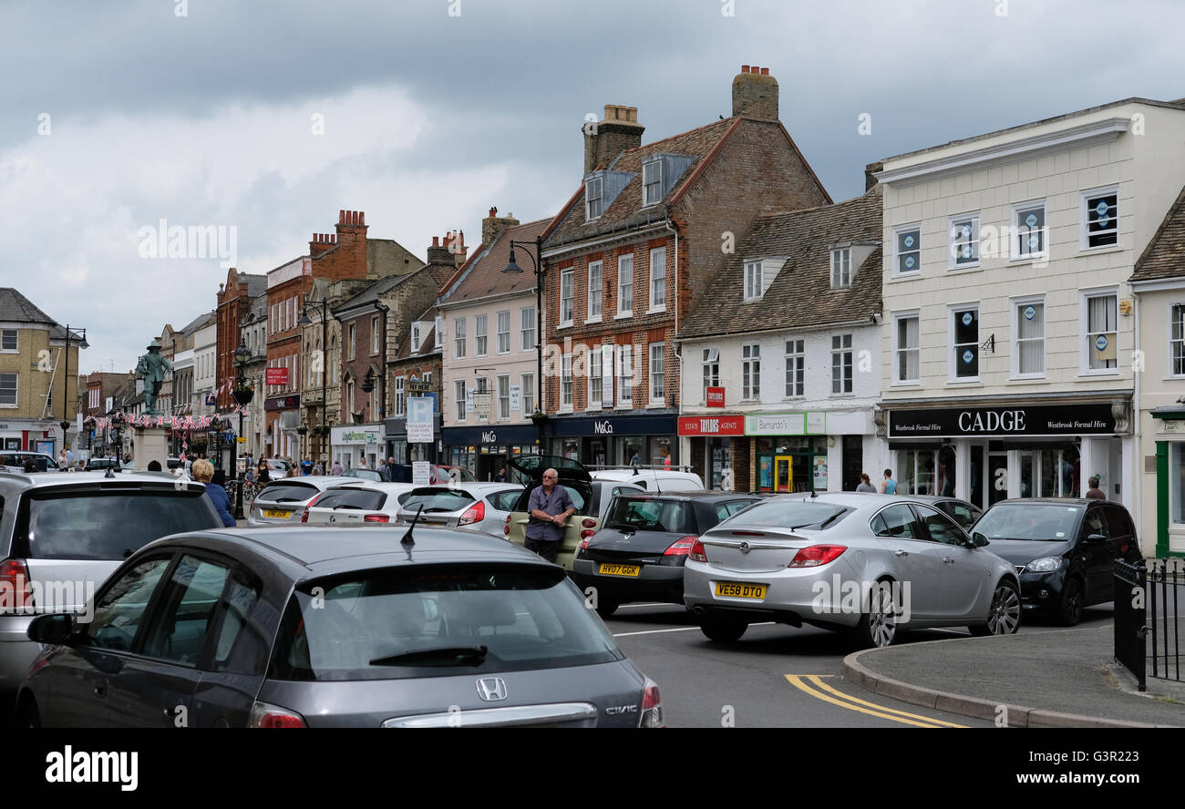 Busy market town of Saint Ives, Cambridgeshire as seen on a Saturday. Notice the congestion caused bar cars in the - Stock Image