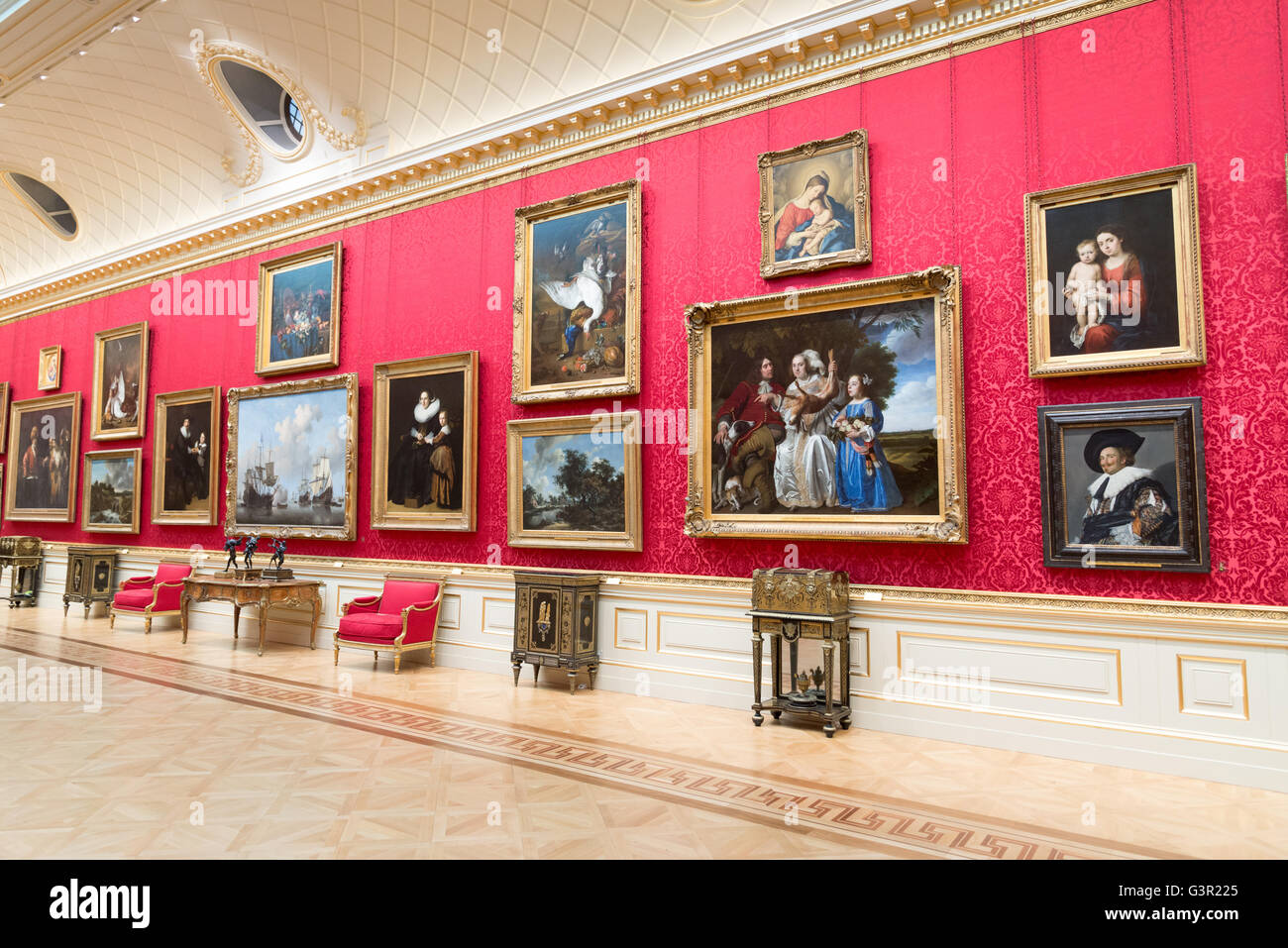 Oil paintings in the Great Gallery in the Wallace Collection art gallery, London, England, UK - Stock Image