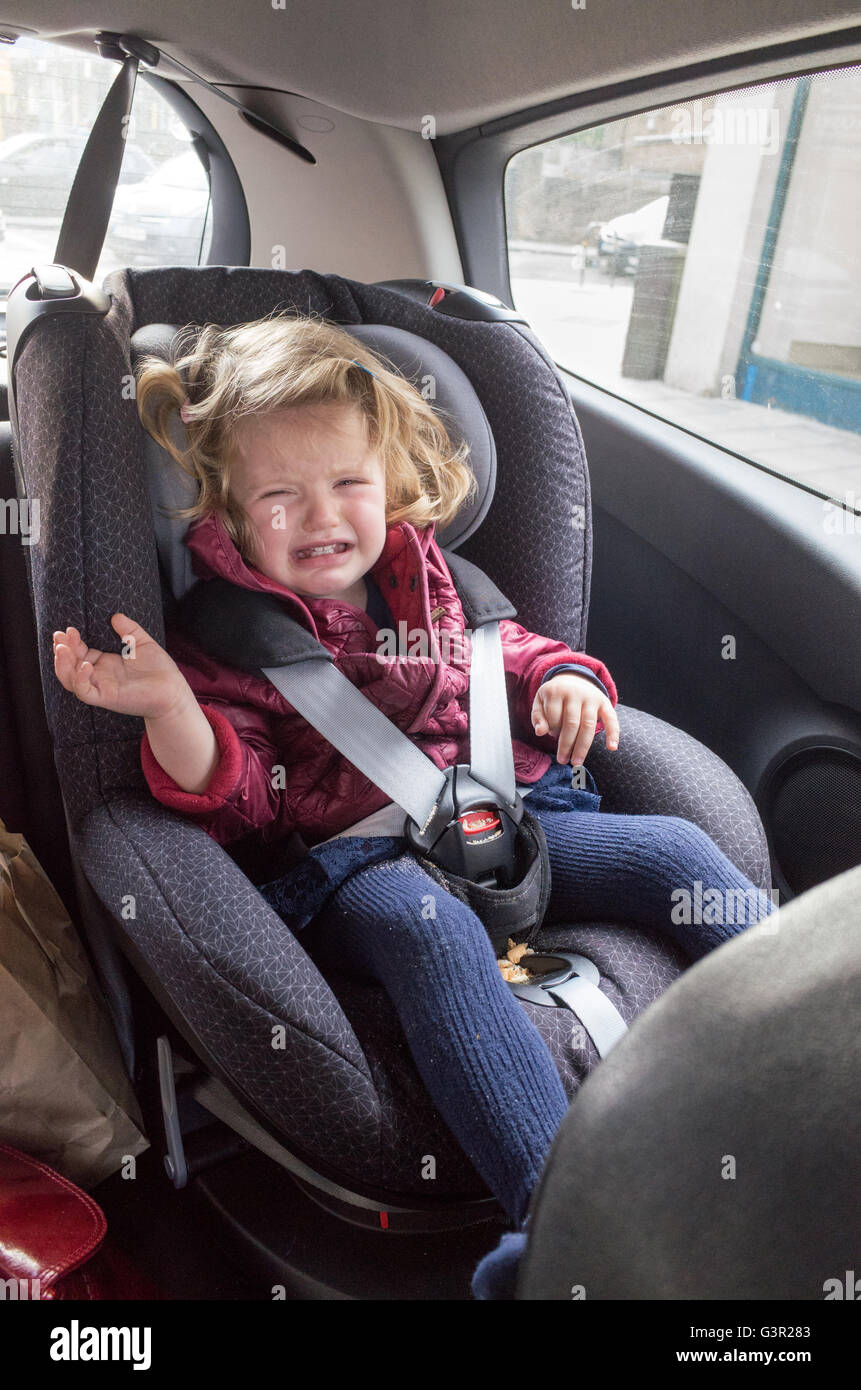 Two Year Old Toddler Crying In Her Car Seat England Uk