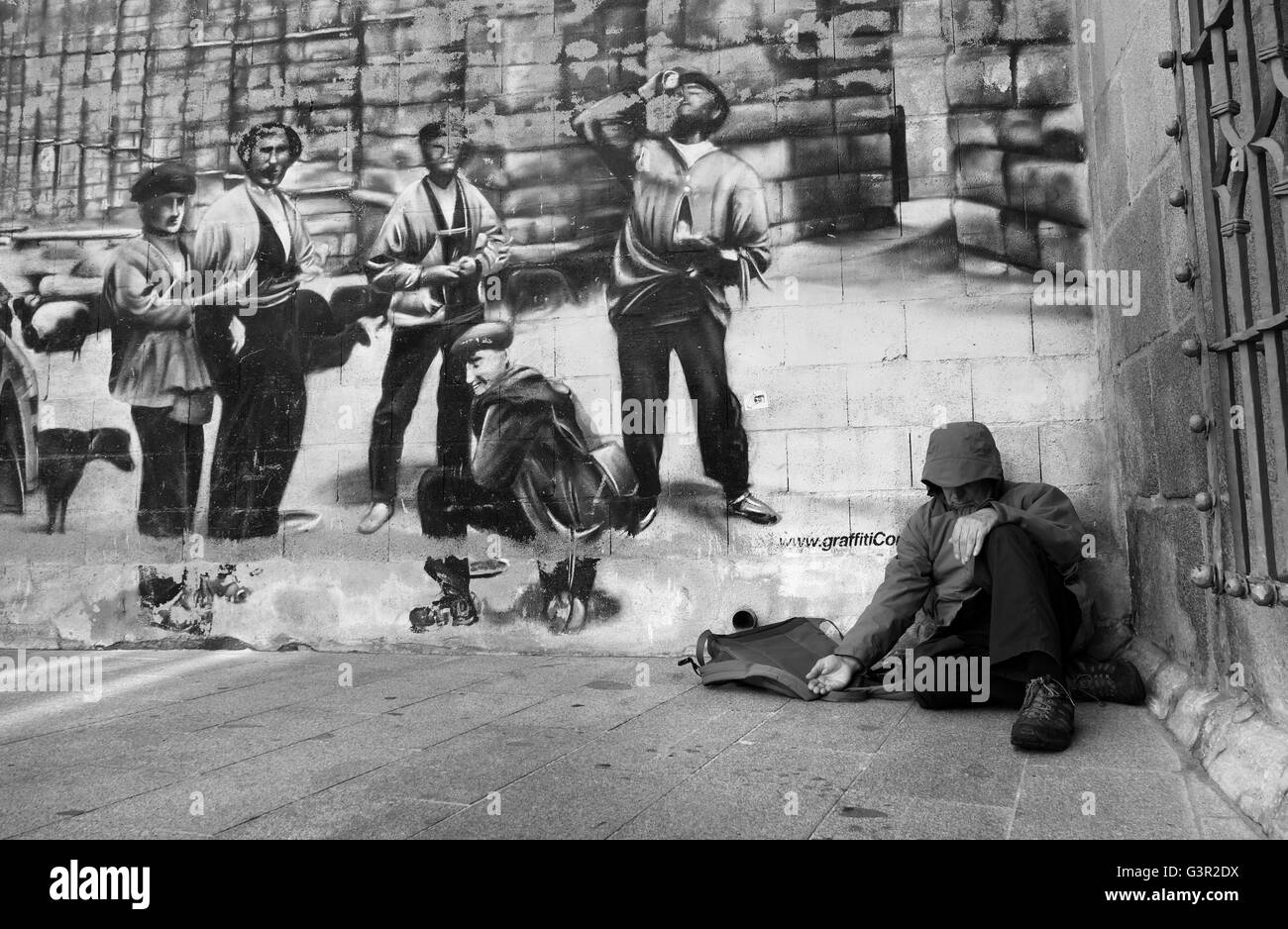 Man begging in street in Spain - Stock Image