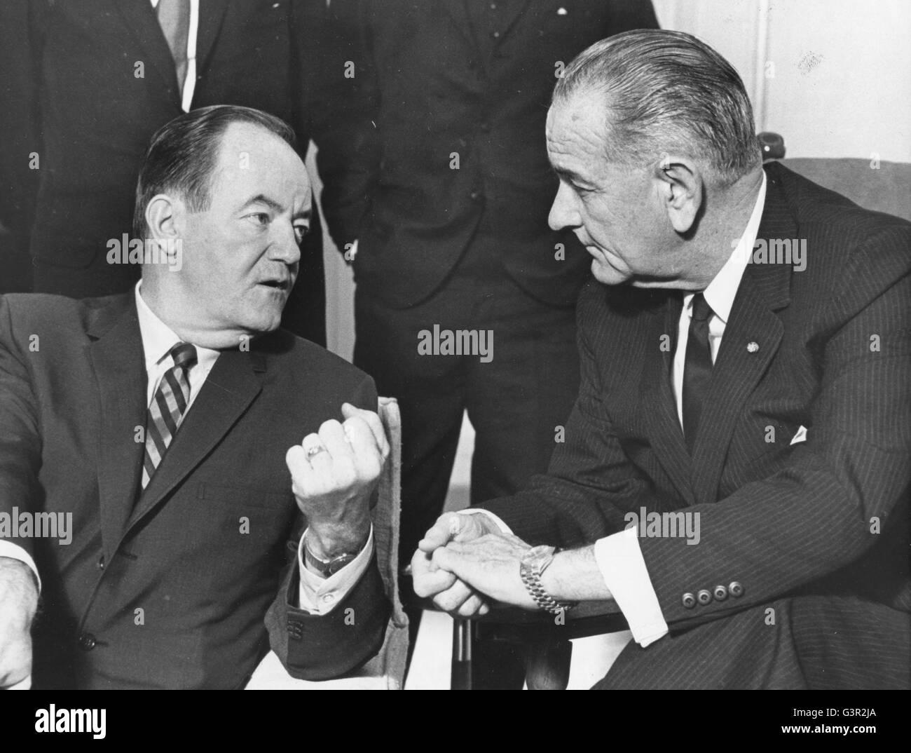 President Lyndon B. Johnson listens to Vice-President Hubert H. Humphrey's report of his five-day Far East tour. - Stock Image