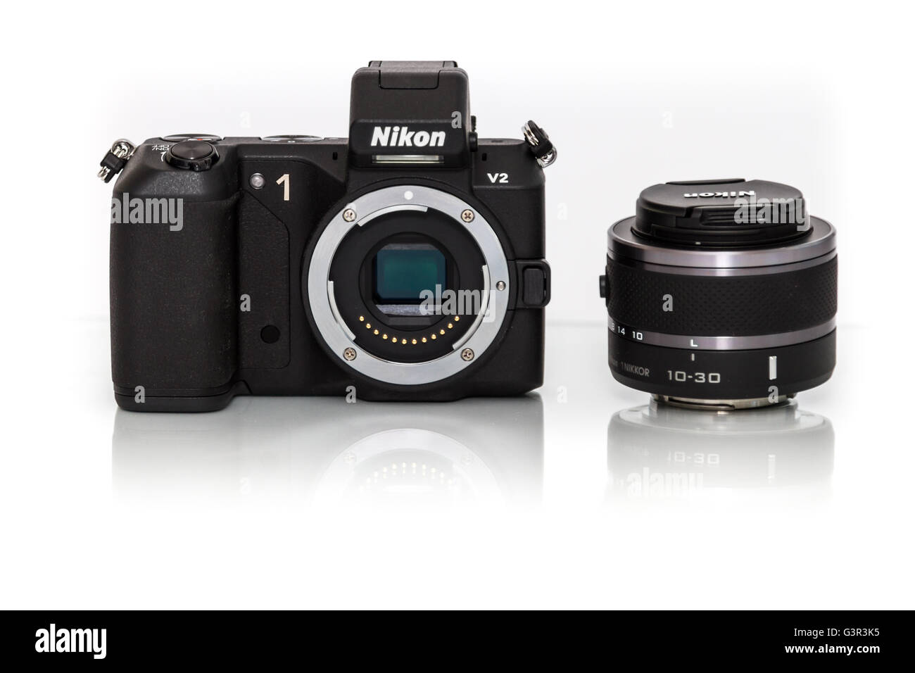 Stock Photo - Nikon 1 V2 compact mirrorless camera - ultra small system - Stock Image