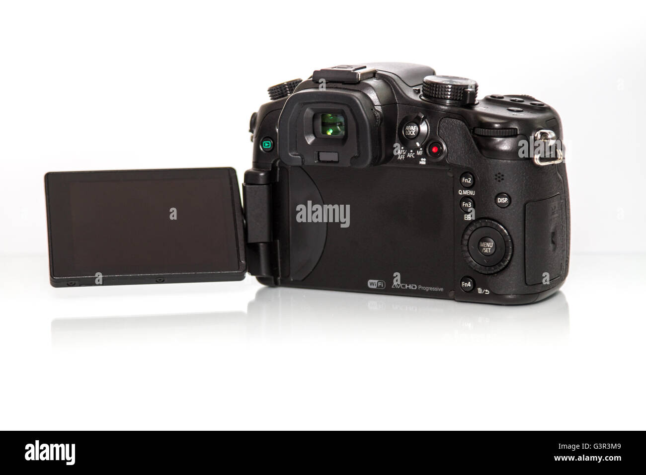Stock Photo - A  Panasonic Lumix GH3 camera from back with rotating display - Stock Image
