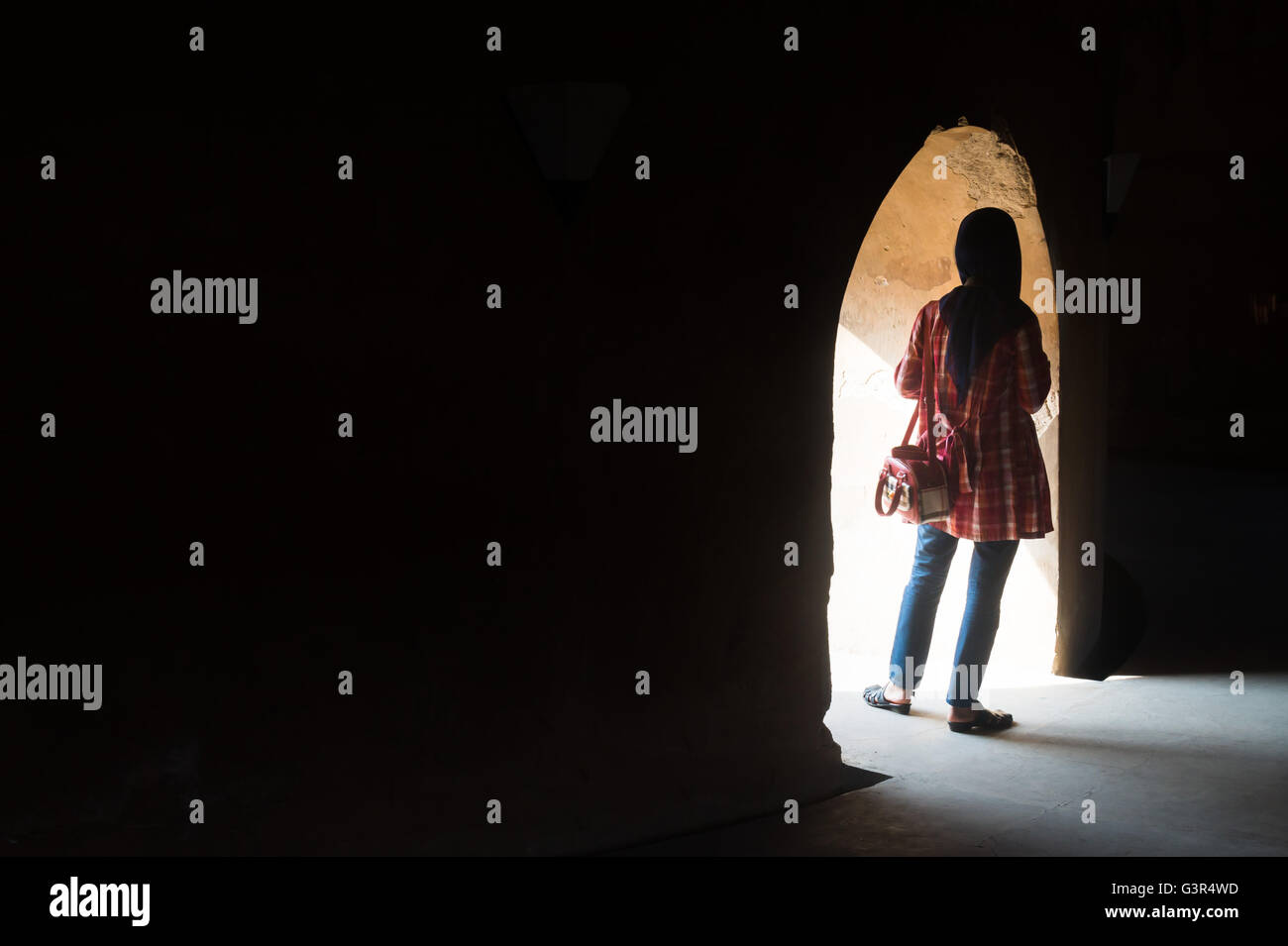 Hijab Women in front of hole - Stock Image