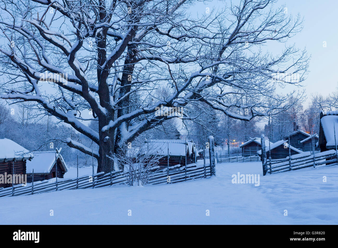 Sweden, Dalarna, Mora, Wooden houses covered with snow - Stock Image