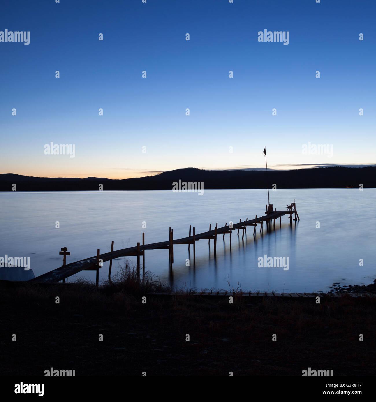 Sweden, Dalarna, Siljan, Solleron, Lake in winter at dusk Stock Photo