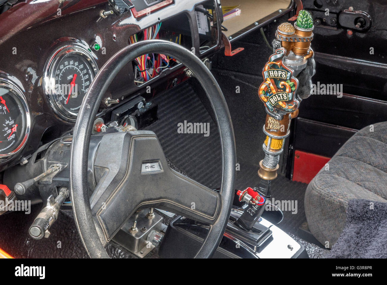 Close Up Inside Of A Rat Rod Truck With A Custom Beer Tap Gear Stick Shifter, Still A Work In Progress - Stock Image