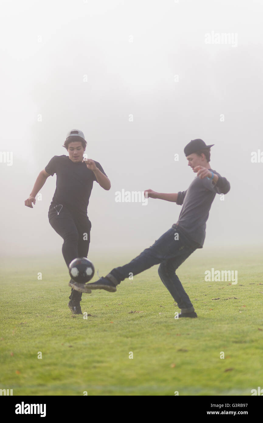 Sweden, Vastmanland, Teenage boys (14-15) playing soccer - Stock Image