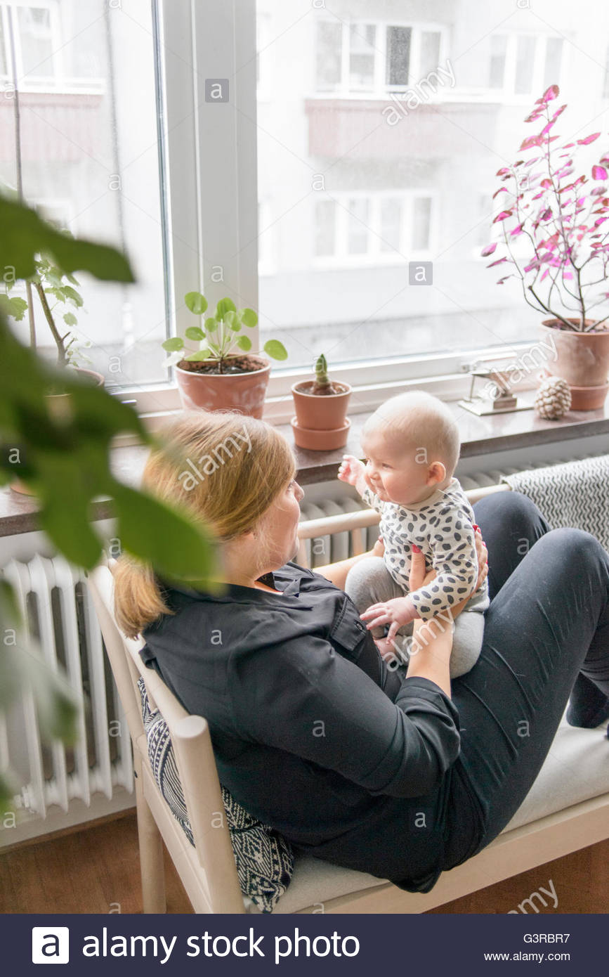 Sweden, Mother playing with baby boy (0-1 months) - Stock Image