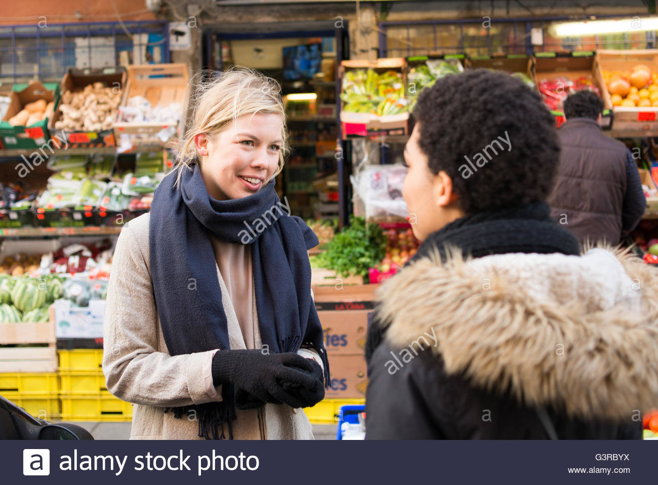 Sweden, Skane, Malmo, Two young women talking Stock Photo
